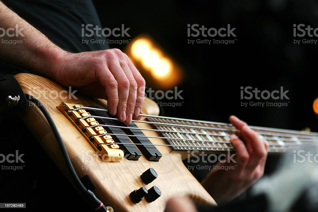 Close-up of an electric bass player's hands stock photo