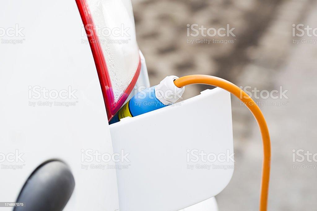 Closeup of an electric car plug while recharging royalty-free stock photo