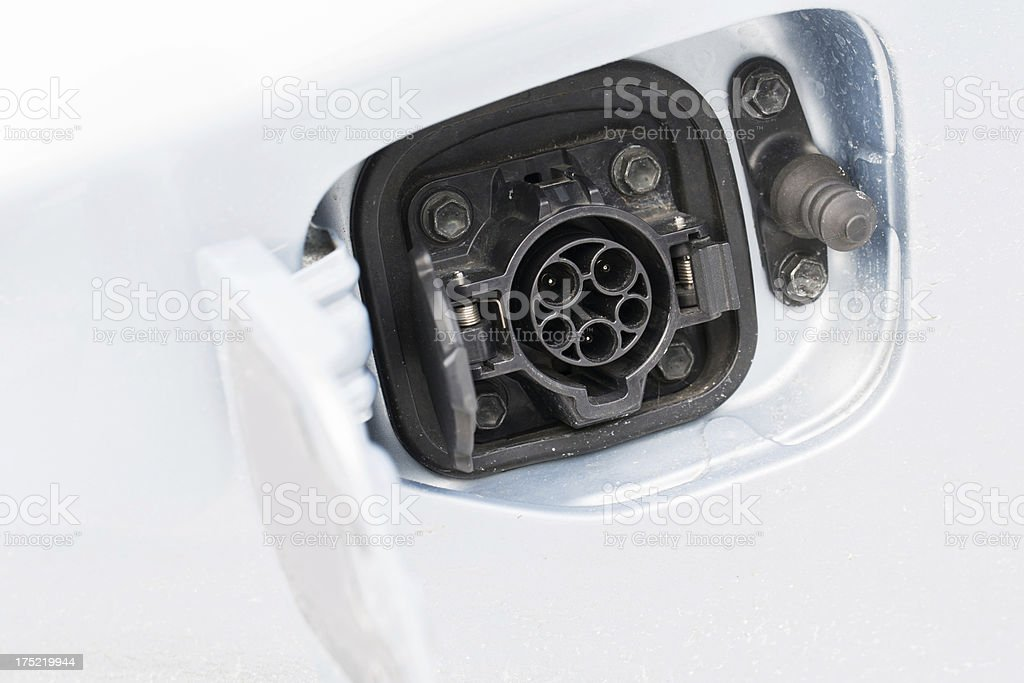 Closeup of an electric car plug while recharging royalty-free stock photo
