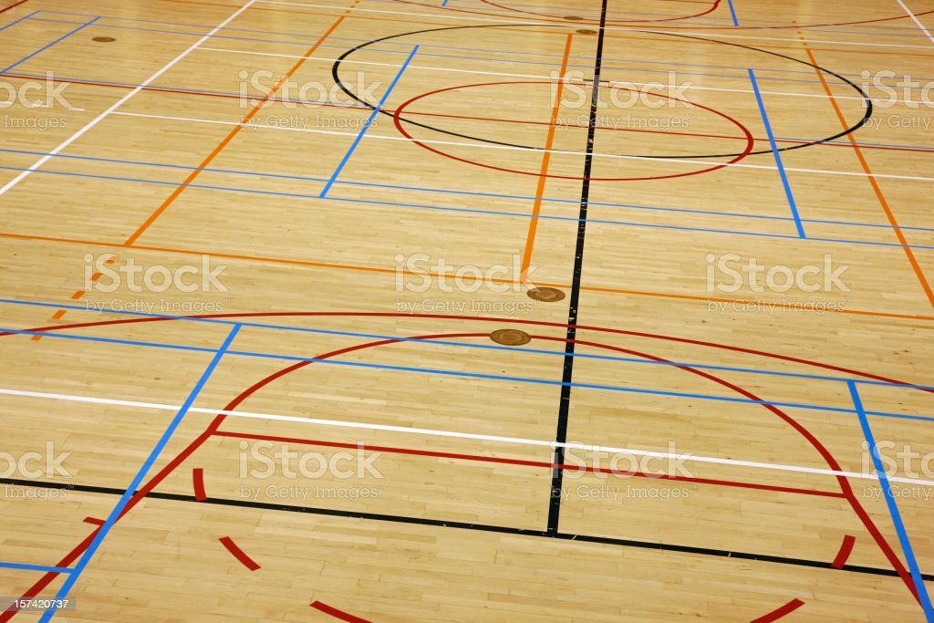 Close-up of an empty wooden gym flooring, shallow DOF royalty-free stock photo
