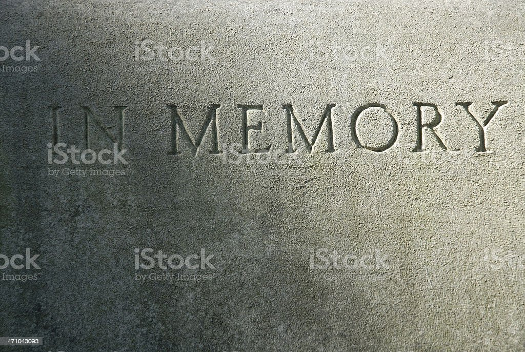 Close-up of an engraving on a cement grave royalty-free stock photo