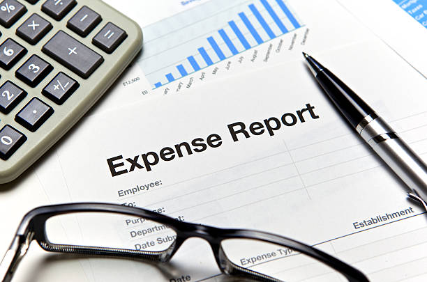 Close-up of an expense report with glasses and a calculator Close up of an expense form with calculator and pen. expense stock pictures, royalty-free photos & images