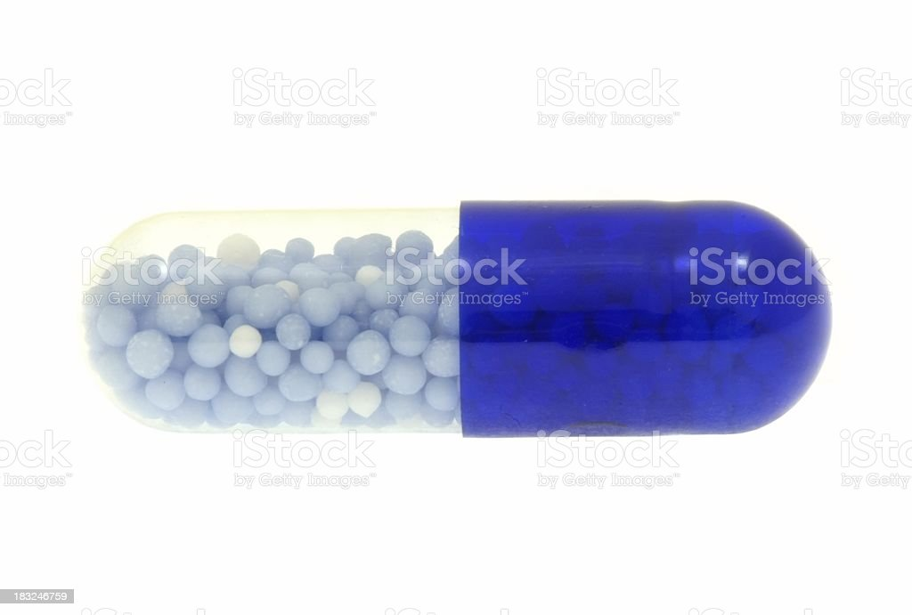 Close-up of an isolated blue capsule royalty-free stock photo