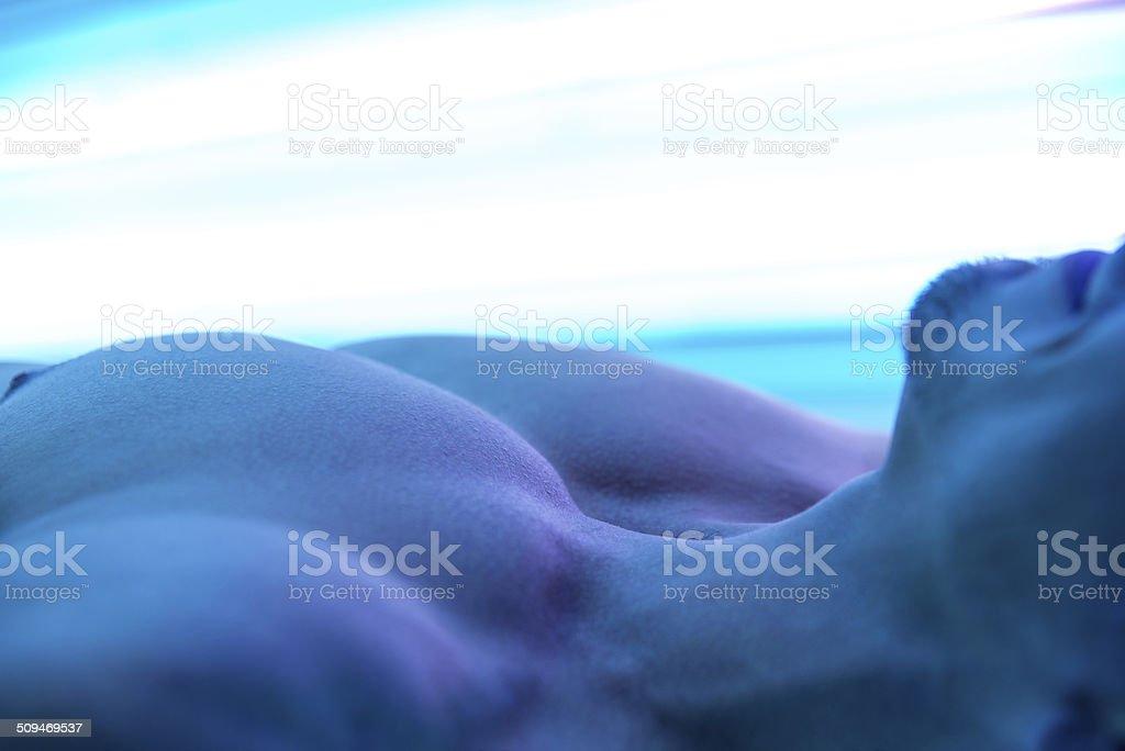 Close-Up Of An Man Having Solarium Beauty Treatment stock photo