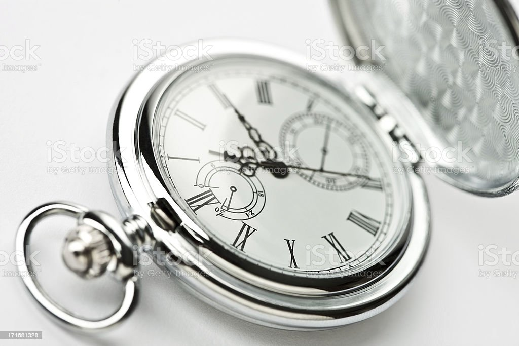 Closeup of an old fashioned silver pocket watch royalty-free stock photo