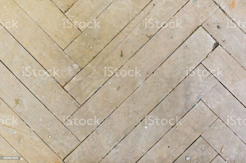 A close-up of an old gray faded parquet covered with dust and dirt. Result of repair. Cleaning and cleaning required - Royalty-free Backgrounds Stock Photo