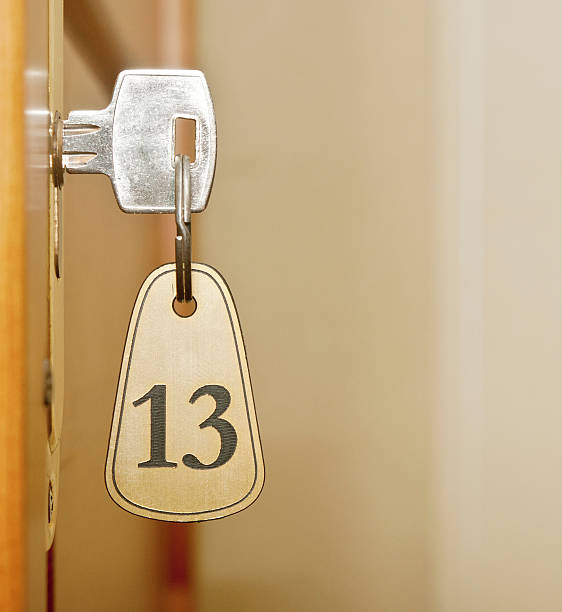 Closeup of an old keyhole of room number 13 stock photo