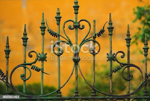 close-up of an old ornate gate in wrought iron. Tuscany, Italy