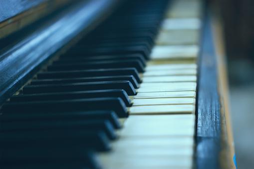Close-up of an old piano keyboard.