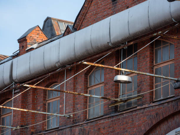 A close-up of an old red brick industrial factory building. stock photo