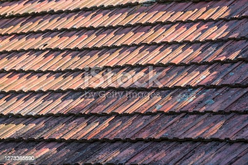 istock Close-up of an old roof covered with stone bricks 1273365890