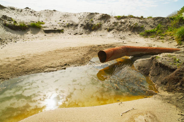 Closeup of an old water pipe in an arid region of a sandy desert. stock photo
