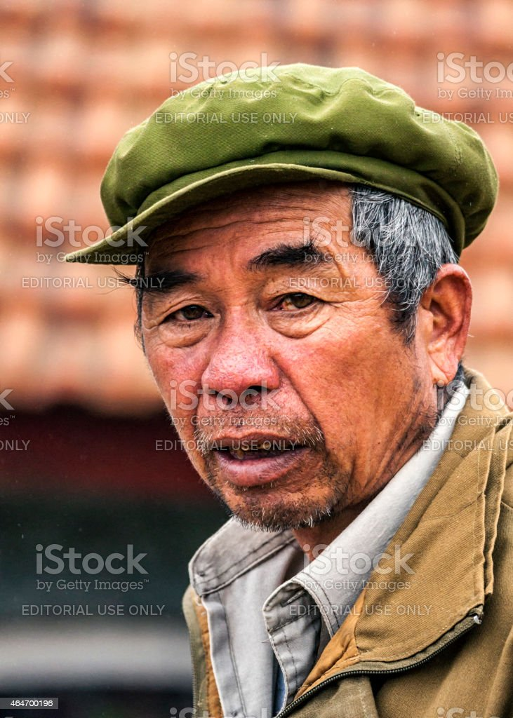 Closeup of an older wan with green hat. stock photo
