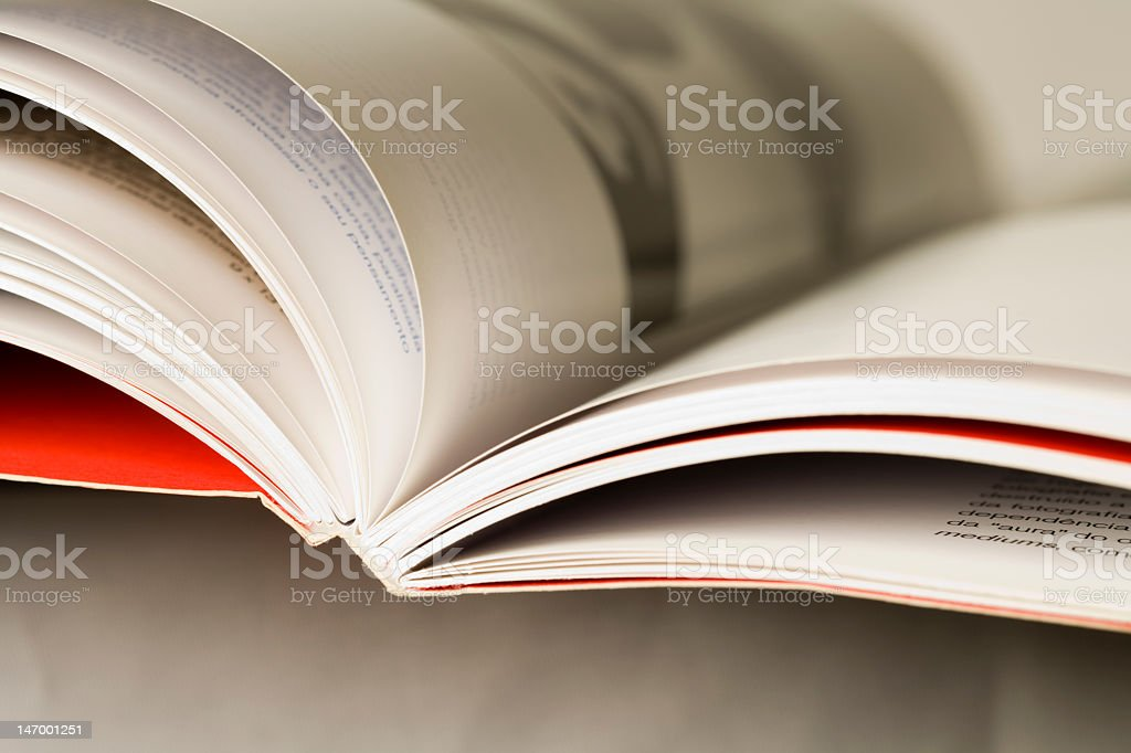A closeup of an open book with a red cover stock photo