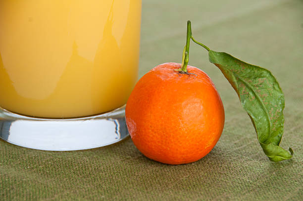 Close-up of an orange and juice