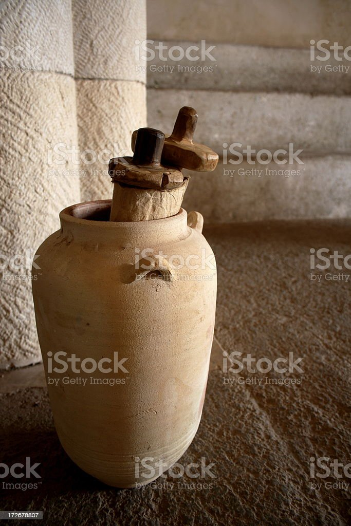 Close-up of ancient scrolls inside an ancient jar stock photo