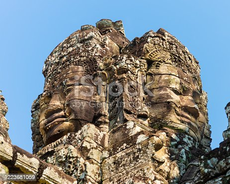 Siem Reap, Cambodia - January 22, 2020: Bayon is a late 12th-century Mahayana Buddhist temple. The Bayon's most distinctive feature is the multitude of serene and smiling stone faces.