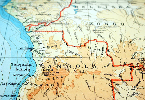 close-up of angola on flat paper map - angola stock photos and pictures