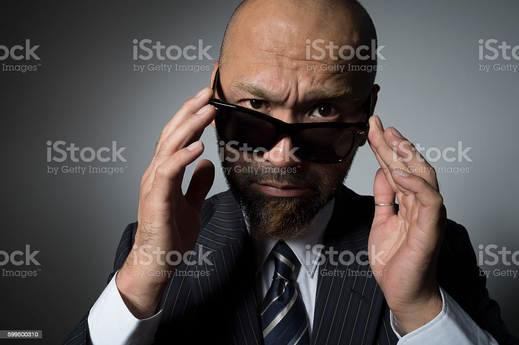 Close-up of angry  businessman. stock photo