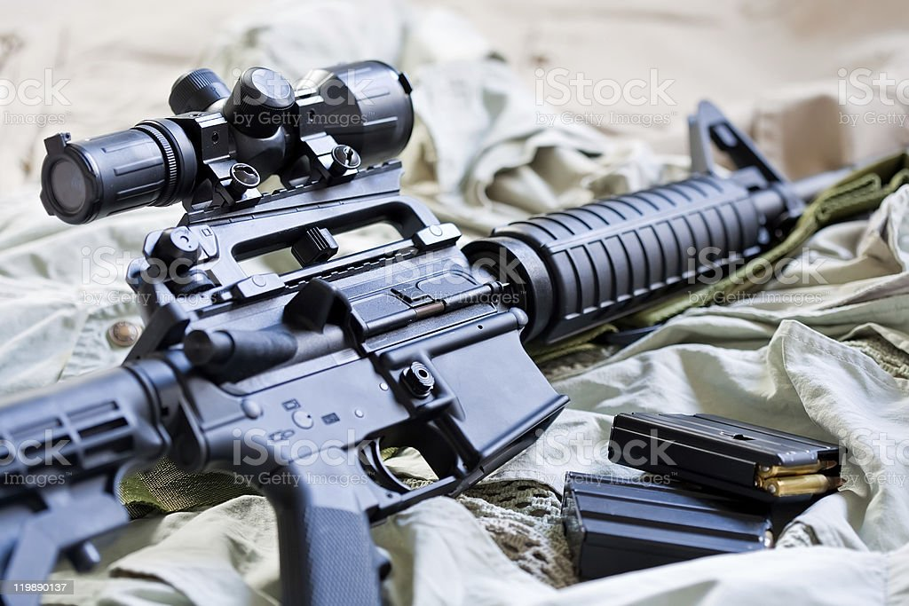 Close-up of AR-15 rifle and magazines with ammo stock photo