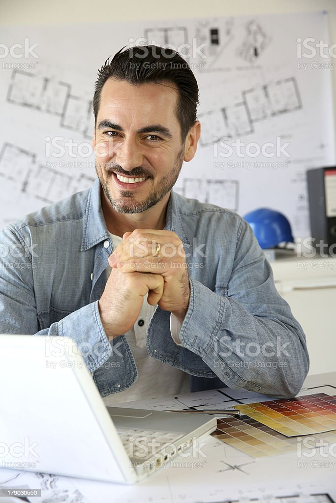 Closeup of architect in office with joined fists royalty-free stock photo