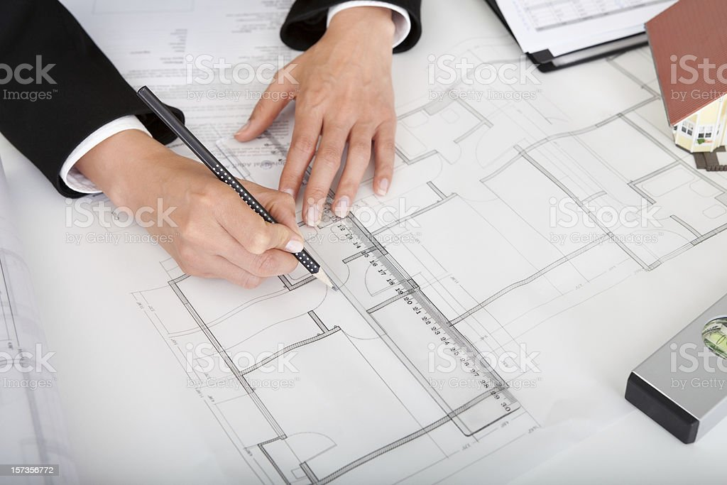 Closeup Of Architect Working On Blueprint royalty-free stock photo