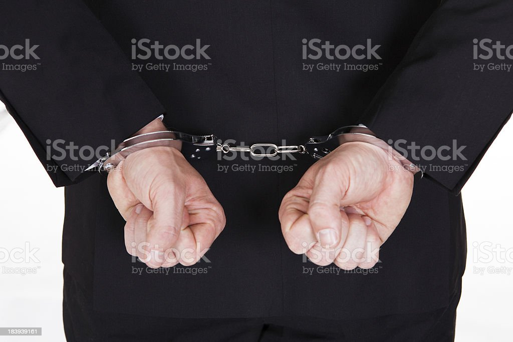 Close-up of arrested businessman royalty-free stock photo