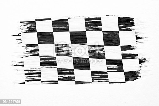 istock Closeup of art brush watercolor painting checkered black and white racing flag blown in the wind isolated on white. 934554756