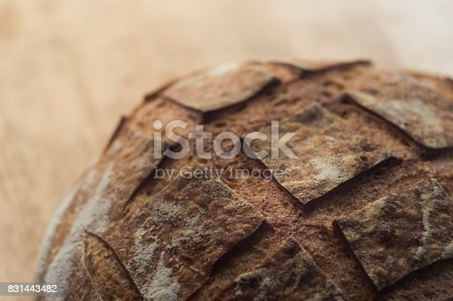 istock Close-up of artisan bread on wooden background 831443482