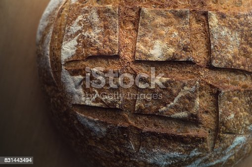 913749618istockphoto Close-up of artisan sourdough bread on wooden table 831443494