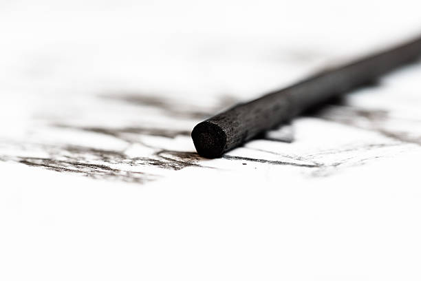 close-up of artist's charcoal stick sketching on white - charcoal drawing stock photos and pictures