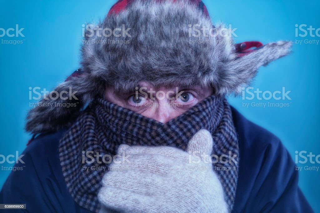 Close-up of as very cold Caucasian male looking at camera stock photo