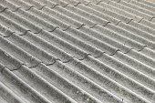 closeup of asbestos roof pattern in background