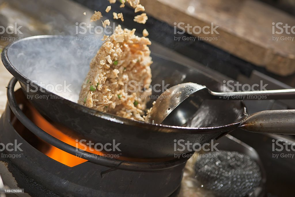 Close-up of Asian stir-fry cooking in a wok stock photo