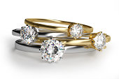istock Close-up of assorted diamond rings in white background 464205193