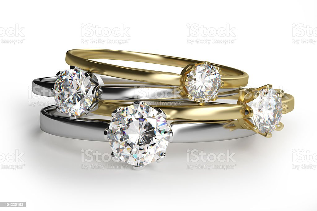 Close-up of assorted diamond rings in white background stock photo