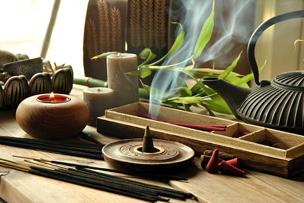 Close-up of assorted incense products representing Zen idea VARIOUS TYPES OF INCENSE WITH TEAPOT AND BUDDHA STATUE incense stock pictures, royalty-free photos & images