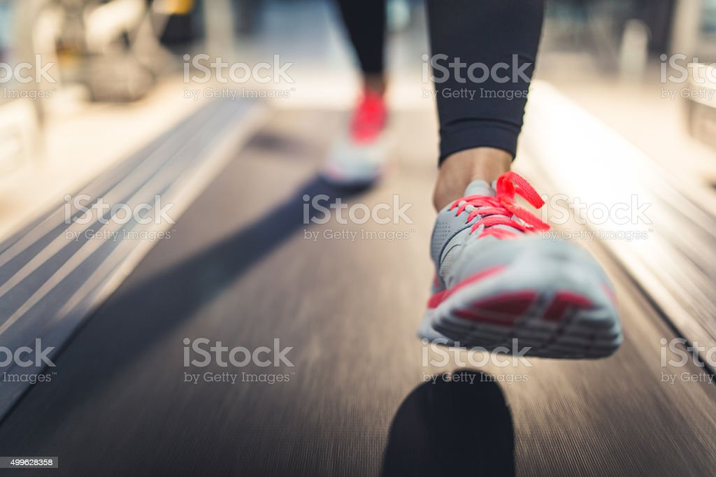 Close-up of Athlete shoes while running on treadmill stock photo