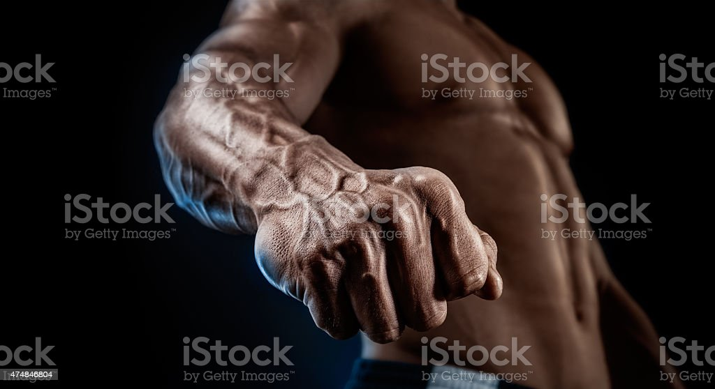 Close-up of athletic muscular arm and torso stock photo