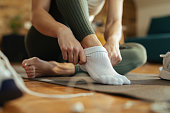 istock Close-up of athletic woman putting on socks. 1210121260