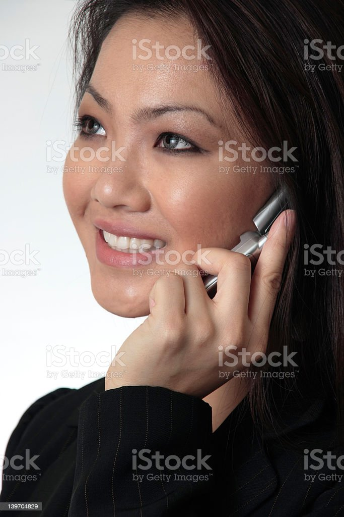Close--up of Attractive business woman talking on cell phone royalty-free stock photo