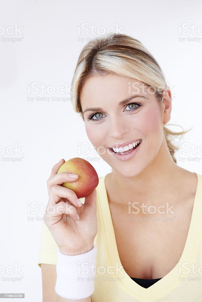 closeup of attractive woman eating an apple royalty-free stock photo