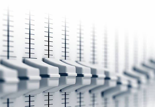 Close-up of audio switches in different settings stock photo