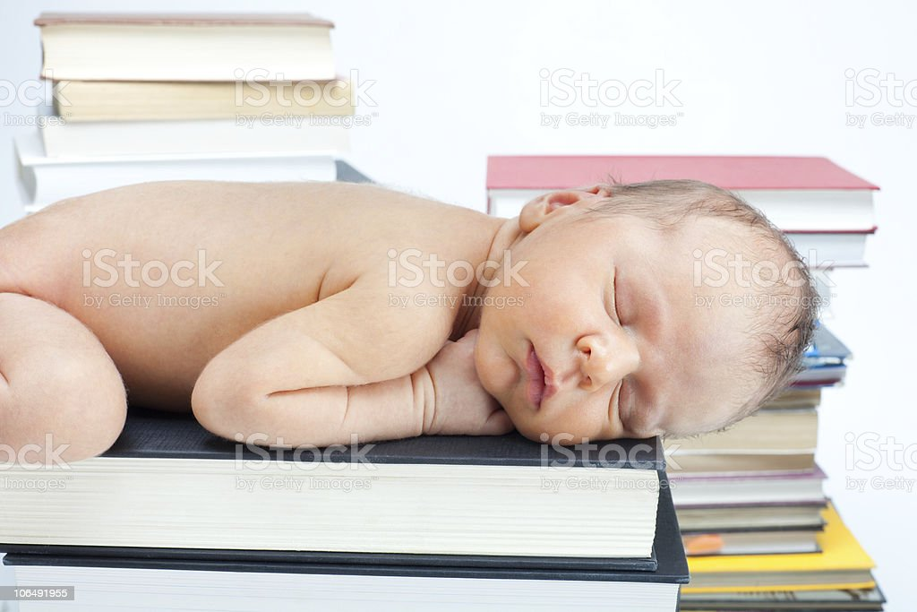 Close-up of baby sleep on the books royalty-free stock photo