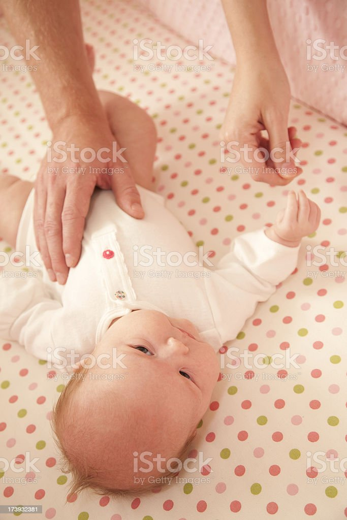 Closeup of baby with parents hands in the frame royalty-free stock photo