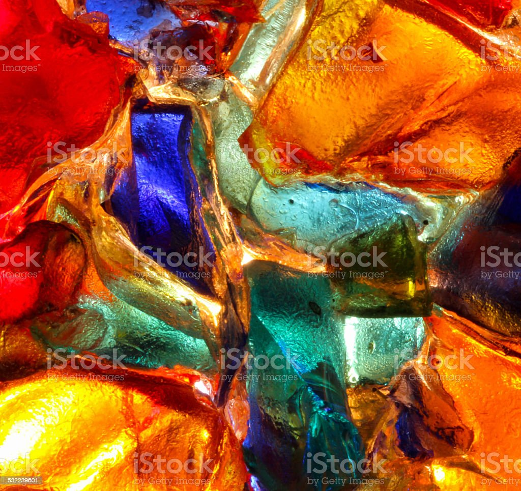 Closeup of back lit stained abstract glass pattern stock photo