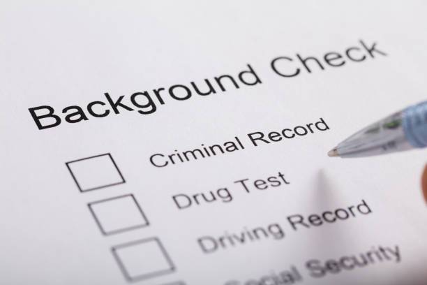 Close-up Of Background Check Form Close-up Of Pen Over Background Check Form criminal stock pictures, royalty-free photos & images