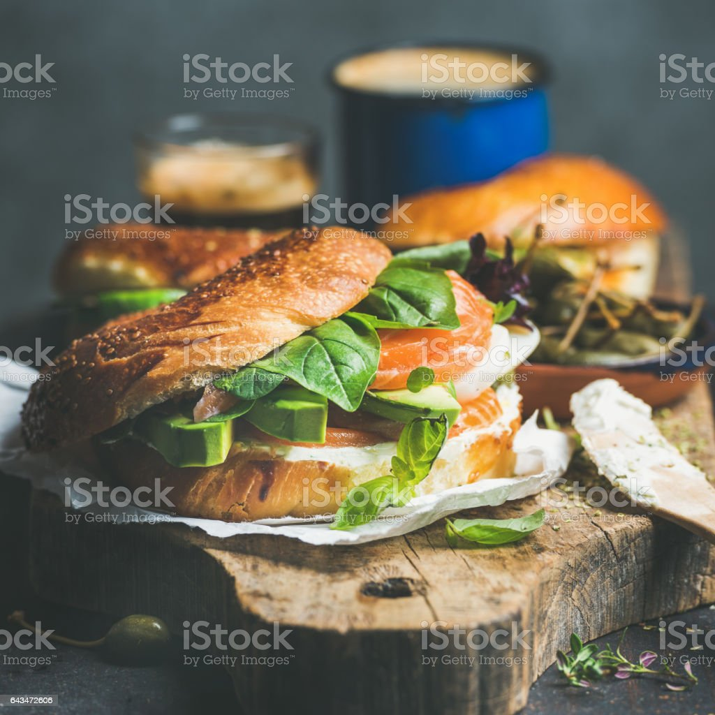 Close-up of bagel with salmon, cream-cheese, vebegables and coffee espresso stock photo
