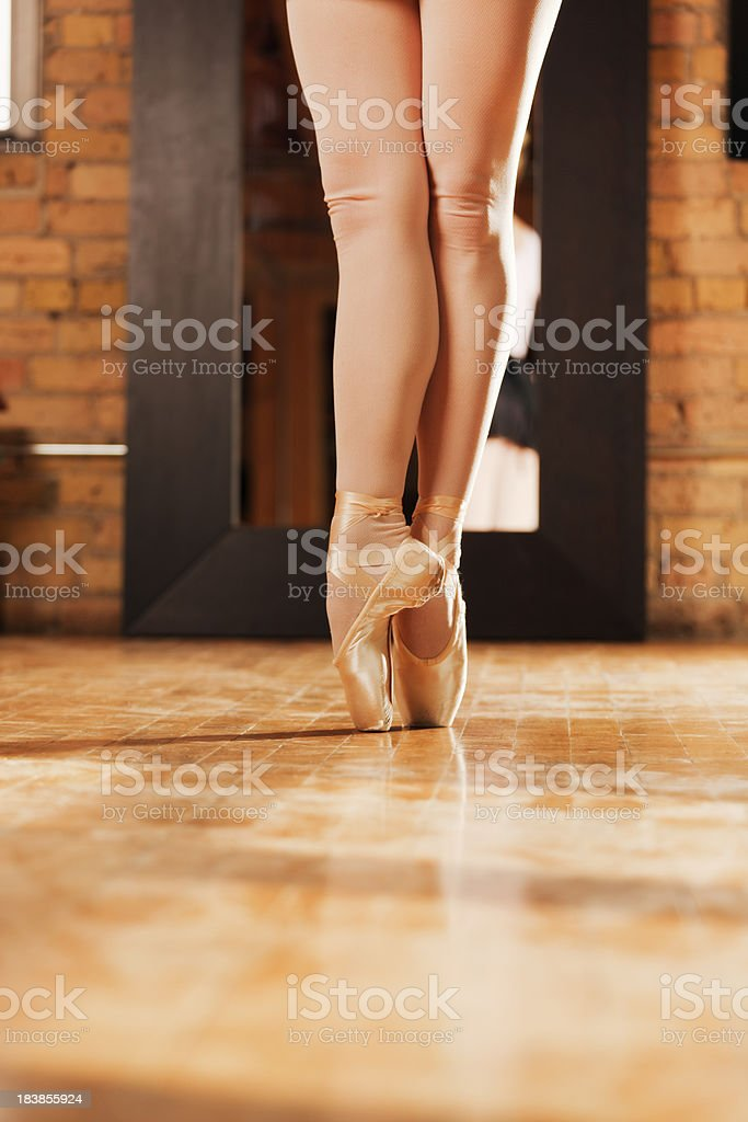 Close-up of Ballet Dancer En Pointe in Dance Studio stock photo