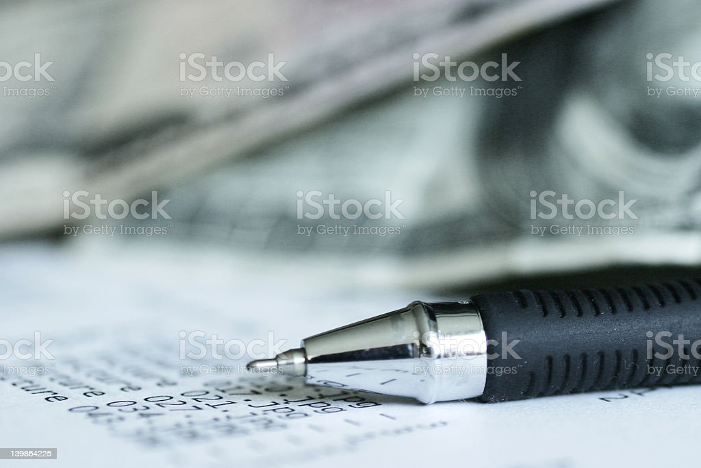 Close-up of ballpoint pen and financial figures royalty-free stock photo